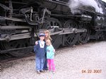 Picture Title - Charlie Ally and Becky stand in front of the masive drivers of 3751.