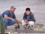Picture Title - Isaiah and Dad checking cement